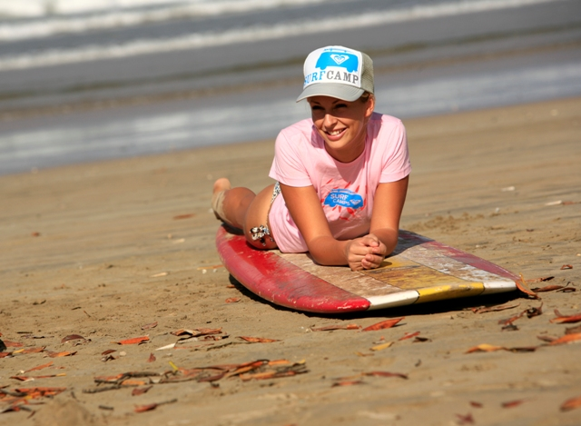 Learn to surf using our free board rentals and beach equipment!